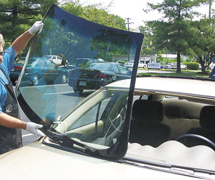 picture of PF Auto Glass Inc performing a windshield replacement in a parking lot